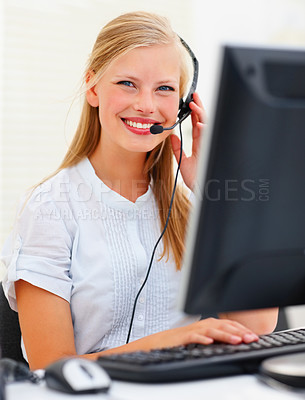 Buy stock photo Cute young business woman working on the computer