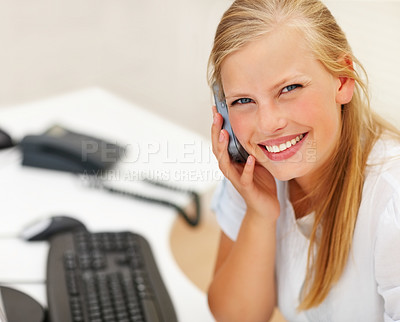 Buy stock photo Happy business woman enjoying a conversation on the mobile at work