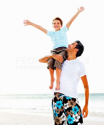 Buy stock photo Happy father carrying his son on his shoulder with a seascape as the background and bright copyspace