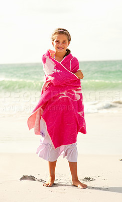 Buy stock photo Full length of a young girl covered in a pink towel at the sea shore