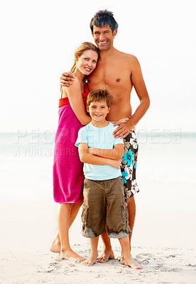Buy stock photo Full length image of a family smiling while at the sea shore