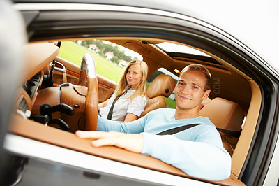 Buy stock photo Beautiful young couple relaxing in the comfort of their new car