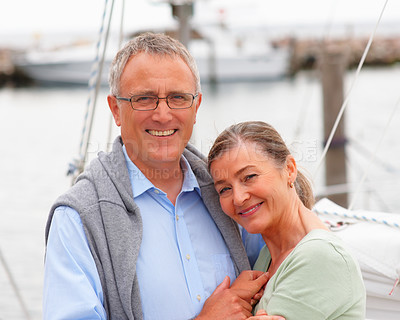 Buy stock photo Portrait of a happy retired couple embracing on sailboat