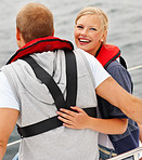 Happy cute female sitting with her boyfriend during a sea voyage