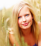 Cute female smiling while at a field