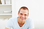 Smart young man smiling while at home