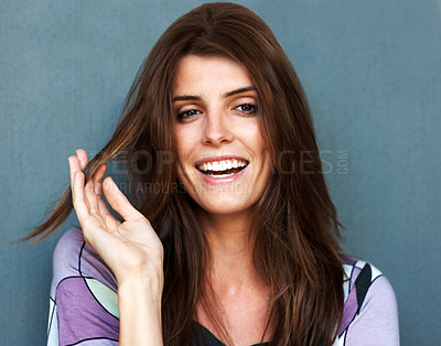 Buy stock photo Beautiful young fashion model smiling over grey ba