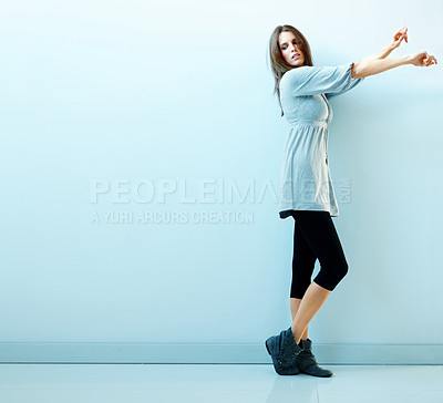 Buy stock photo An attractive young female standing and posing aga