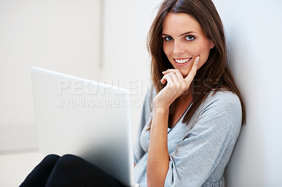 Buy stock photo Attractive thoughtful young woman sitting on floor