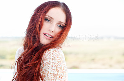 Buy stock photo A gorgeous young redheaded woman standing outside