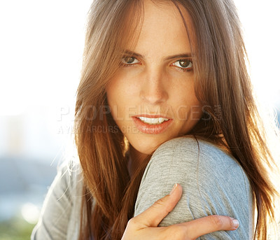 Buy stock photo Portrait of a beautiful young woman looking at you seductively - copyspace