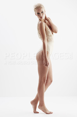 Buy stock photo A gorgeous blonde woman modeling her lace fashion in a studio shoot