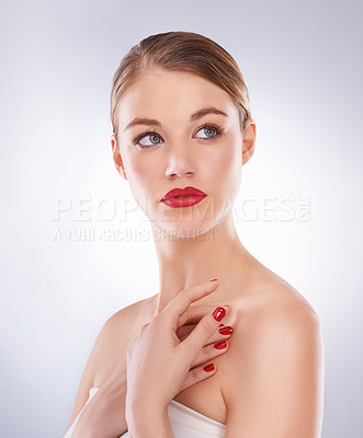 Buy stock photo Studio shot of a beautiful young model with bright red lipstick and nail polish