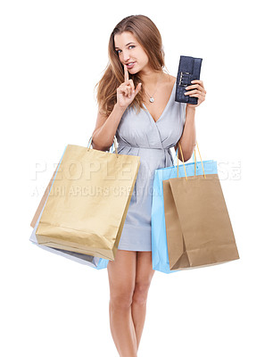 Buy stock photo Portrait of an attractive young woman with her finger on her lips while out shopping