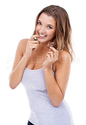 Buy stock photo An attractive young woman eating a piece of chocolate