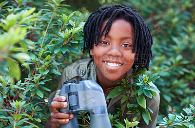 Buy stock photo A young child holding binoculars