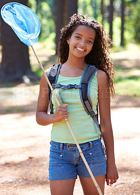 Buy stock photo A young girl with a butterfly net in a forest