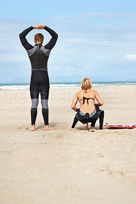 Buy stock photo Rearview of two surfers looking at the ocean