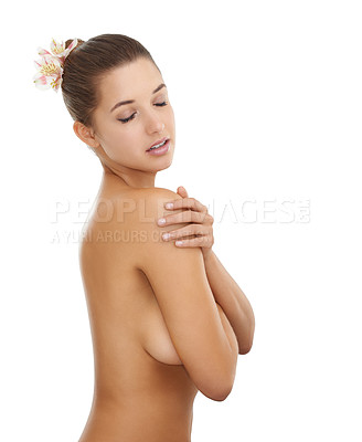 Buy stock photo A beautiful young woman standing naked against a white background covering her breasts