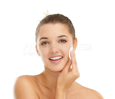 Buy stock photo Studio shot of a young woman cleansing her skin isolated on white