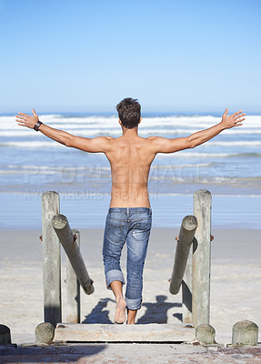 Buy stock photo Rear-view of a young man on his way to the beach