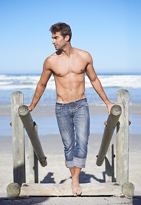 Buy stock photo A young man at the beach
