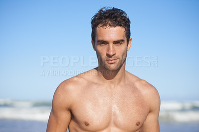 Buy stock photo Cropped portrait of a handsome man at the beach