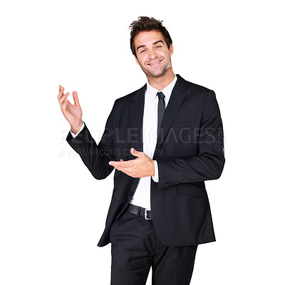 Buy stock photo Studio shot of a handsome man in a suit gesturing to copyspace isolated on white