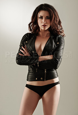 Buy stock photo A confident young woman posing in a leather jacket and black panties