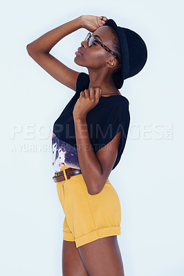 Buy stock photo A stylish african american woman posing in the latest fashion in a studio shoot
