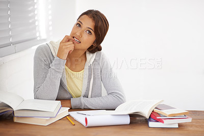 Buy stock photo A beautiful college student trying to overcome a study block in her dorm room