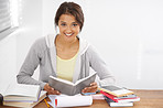 Hitting the books with a smile on her face