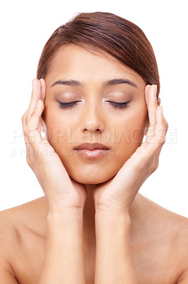 Buy stock photo A beautiful young ethnic woman rubbing her face