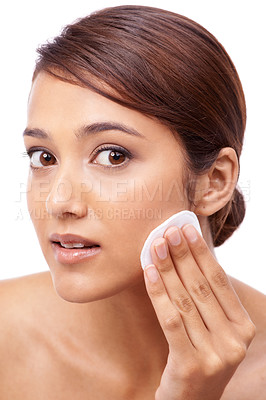 Buy stock photo Portrait of a beautiful young woman moisturizing her face