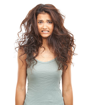 Buy stock photo A beautiful woman looking at the camera looking perturbed by her damaged hair