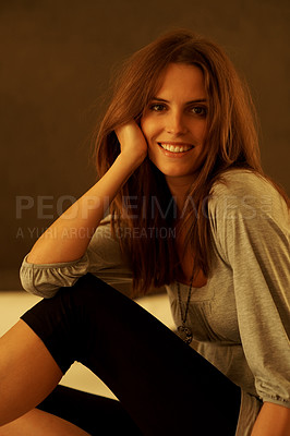 Buy stock photo Pretty young woman posing against brown background