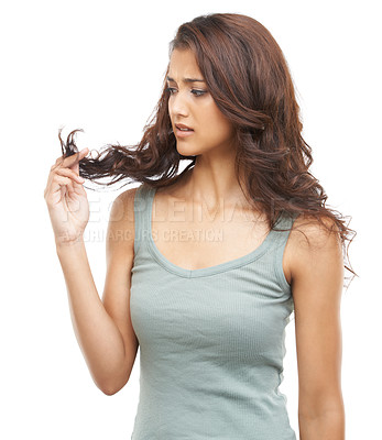 Buy stock photo A stunning woman battling with split-ends while isolated on a white background