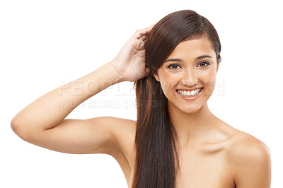 Buy stock photo A young woman holding her hair in a ponytail and smiling at the camera