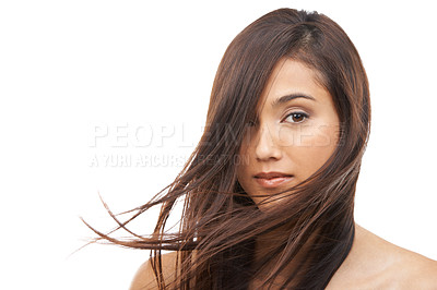 Buy stock photo An attractive young woman with beautiful long hair isolated on white