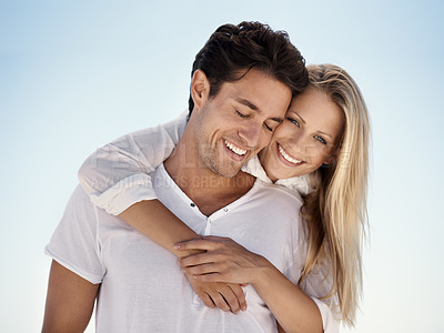 Buy stock photo A happy couple hugging each other on the beach