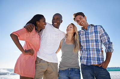 Buy stock photo Cropped portrait of two happy couples enjoying a day at the beach