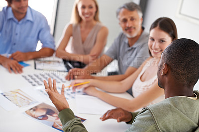 Buy stock photo A group of business people choosing models for an advertising campaign they are working on