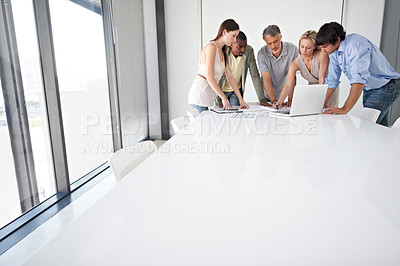 Buy stock photo A group of business people sitting around a boardroom table