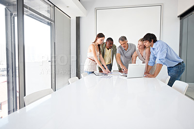 Buy stock photo Five colleagues using a laptop in the