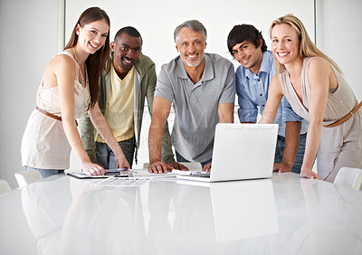 Buy stock photo Five colleagues using a laptop in the boardroom