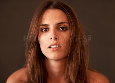 Buy stock photo Thoughtful young lady against brown background