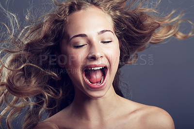 Buy stock photo An attractive young woman with her eyes closed in studio