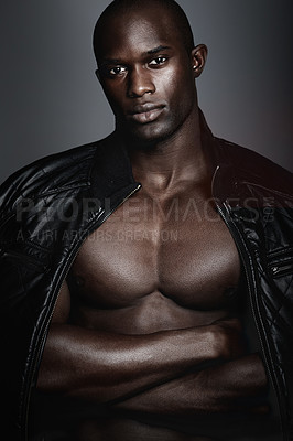 Buy stock photo A handsome african man modeling clothes in studio