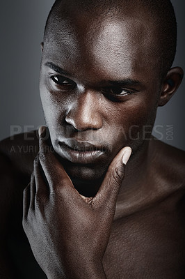 Buy stock photo An african male looking thoughtful in studio