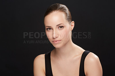 Buy stock photo A naturally beautiful young woman isolated against a black background - cropped